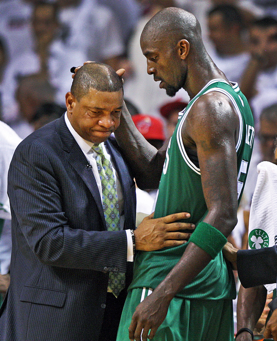 Celtics head coch Doc Rivers and Kevin Garnett share a moment on the sidelines after Garnett left the game as the clock was winding down in the game and on the Boston season, as they fall to the Heat in Game Seven of the NBA Eastern Conference Finals