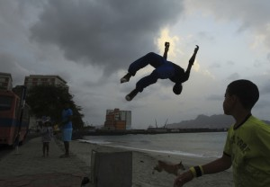 Sao Vicente, Cape Verde 041512 Young men practice parkour moves off a beach-front wall on April 15, 2012 in Sao Vicente, one of several islands which make up the African country of Cape Verde.