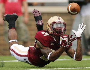Boston College defensive back Manuel Asprilla dives for the ball but couldn't come up with the interception during the second half of their win over Maine at Alumni Field in Boston Saturday, Sept. 8, 2012.