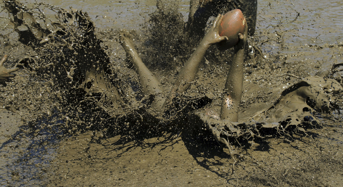 Jamie Sawler of the Mudda's makes an interception against the Cumberland Muckaneers. Mud football teams compete in the annual Mud Bowl, a mud football tournament in North Conway, N.H. at Hog Coliseum.