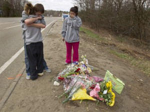 4/8/12      Foxborough, MA       Summer Anderson, 16, hugs friend, Jason Beausolei, 16, as D'Angela Alberty, looks on at the scene of the fatal car crash last night that took the life of their best friend, Michaela Smith on the corner of Route 140 and Walnut Street on Sunday April  8,  2012. Anderson's sister was a passenger in the car crash and survived.