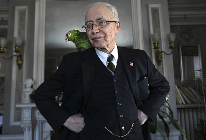 Arlington, MA - 3-8-12 - John Lorimer Worden III at his home with his parrot Tosca.