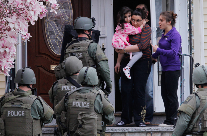 SWAT teams conduct a house to house search as they look for the remaining suspect in the Boston Marathon bombings in Watertown, Massachusetts April 19, 2013.