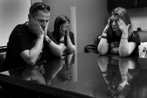 Family members of marathon bombing victim Marc Fucarile are devastated as Dr. Jeremy Goverman tells them in a conference room at Mass. General Hospital that he may have to have his second leg amputated. l-r brother Edward Fucarile, sister Stephanie Baron, and fiancée Jen Regan.