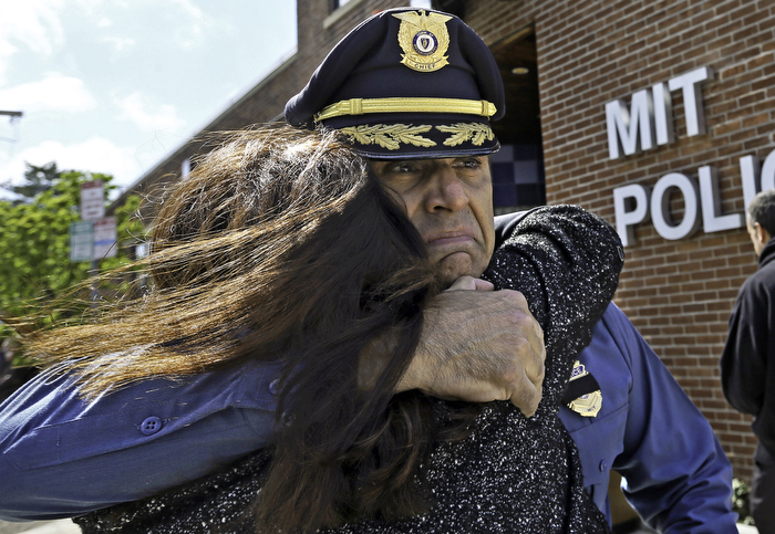 (04/22/13-Cambridge,MA) MIT Police Chief John DiFava is hugged by a member of the MIT community, shortly after a moment of silence that commemorated the one week mark of the Boston Marathon bombings, a terror attack that led to the killing of MIT Police officer Sean Collier. April 22, 2013.