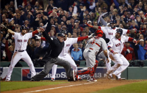 """St. Louis Cardinals catcher Yadier Molina looks back as home plate umpire Jim Joyce calls Boston Red Sox Jonny Gomes safe on a three-run double by Shane Victorino during the third inning of Game 6 of the World Series in Boston. Gesturing """"safe"""" from left are Boston's Jacoby Ellsbury, Xander Bogaerts and David Ortiz."""