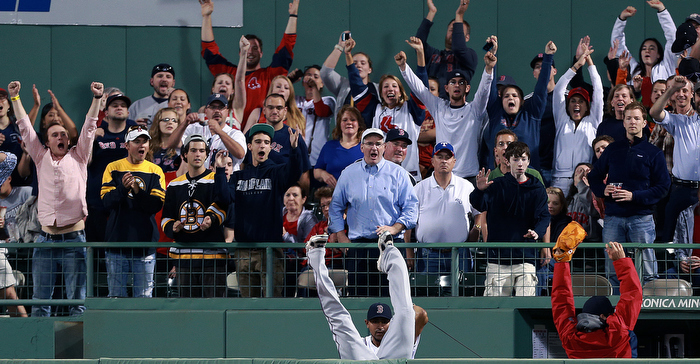 Rangers RF Nelson Cruz made a great effort, but he ended up going over the wall and into the Boston bullpen as he couldn't make the catch on a home run by the Red Sox Mike Carp.