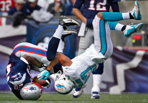 Miami Dolphins safety Jimmy Wilson  flips over as he upends New England Patriots running back LeGarrette Blount after only a gain of 2 yards in the 1st quarter as the New England Patriots take on the Miami Dolphins at Gillette Stadium in Foxboro