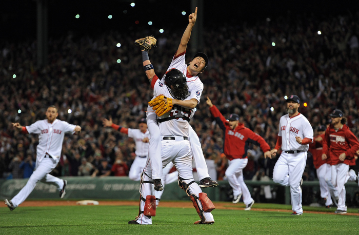 Boston Red Sox relief pitcher Koji Uehara and the rest of the Boston Red Sox celebrate their 5-2 victory over the Detroit Tigers in Game 6 of Major League Baseball's American League Championship at Fenway Park on Sunday, October 20, 2013.