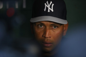 New York Yankees third baseman Alex Rodriguez talks to reporters in the visitors dugout before the Yankees' American League baseball game against the Boston Red Sox at Fenway Park in Boston, Massachusetts August 16, 2013.
