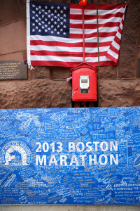 Thousands pay their respects to the victims of the Boston Marathon bombing by signing well wishes on a poster outside the Boston Fire Department station on Boylston Street in Boston, Massachusetts.