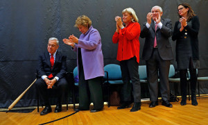 Mayor Tom Menino, days away from leaving office after 20 years as mayor of Boston,  gets a standing ovation from his wife, Angela ,Eileen and Jack Connors and Stacey Lucchino as he attends a event to rename the Hyde Park YMCA in his honor