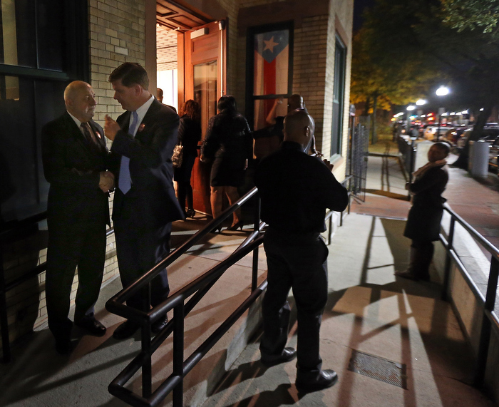 (Boston, MA,10/18/13)   Mayoral Candidate Marty Walsh (2nd from L) talks to ex Boston City Councilor Felix D. Arroyo Sr. (L) outside at the 45th anniversary of the IBA at Villa Victoria Center for the Arts after a Walsh campaign stop.  Friday,  October  18, 2013.