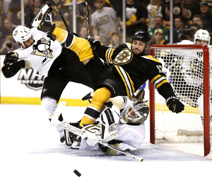 Boston Bruins' Milan Lucic crashes into the Pittsburgh Penguins Goalie during Game 3 of their NHL Eastern Conference finals hockey playoff series in Boston, Massachusetts June 5, 2013.