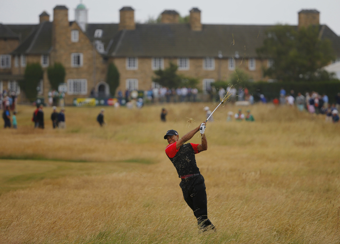 Tiger Woods of the U.S. hits out of the rough on the tenth hole during the final round of the British Open golf championship at Muirfield in Scotland July 21, 2013.