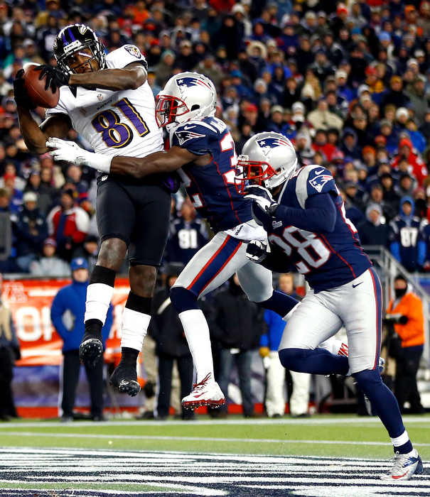 Anquan Boldin #81 of the Baltimore Ravens scores a touchdown passed by Joe Flacco #5 in the fourth quarter against Devin McCourty #32 of the New England Patriots during the 2013 AFC Championship game at Gillette Stadium on January 20, 2013 in Foxboro, Massachusetts.