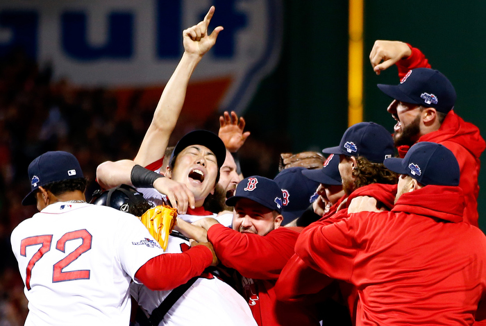 Koji Uehara #19 of the Boston Red Sox celebrates after defeating the Detroit Tigers in Game Six of the American League Championship Series at Fenway Park on October 19, 2013 in Boston, Massachusetts. The Red Sox defeated the Tigers 5-2 to clinch the ALCS in six games.