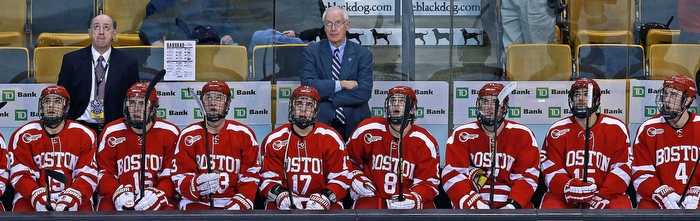 Head coach Jack Parker (center) and his perennial contending Boston University Terriers found themselves in an unfamiliar position in the Beanpot Tournamnet, coming in last as they fell in the consolation game to Harvard. They are pictured as they watch the replay of Harvard's sixth goal of the game, which came in the third period and put the Crimson ahead 6-3.