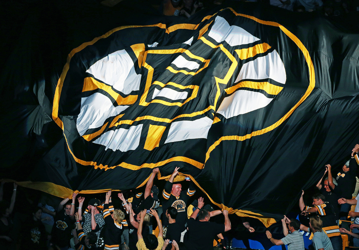 Fans pass a giant Bruins banner through the crowd before the game. The Boston Bruins hosted the Chicago Blackhawks for Game Six of the Stanley Cup Finals at the TD Garden.