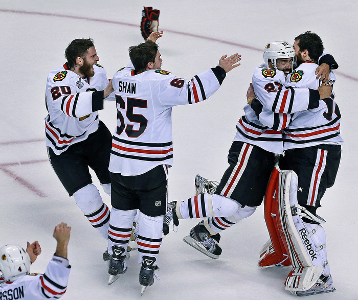 After the final horn sounded in Chicago's incredible last minute come back victory, Johnny Oduya leaps into the arms of goalie Corey Crawford, as other teammates rush to join the party.