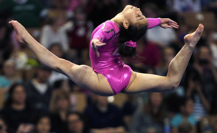 Katelyn Ohashi, of the United States, performs in the floor exercise during the American Cup gymnastics competition in Worcester, Mass., Saturday, March 2, 2013. Ohashi won the event.