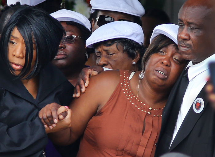 Boston-06/29/13- A funeral service was held for Odin Lloyd at the Holy Spirit Church in Mattapan. His mother, Ursula Ward is helped after the service by his sister Olivia Thibou. Lloyd was allegedly shot to death by former Patriots player Aaron Hernandez.