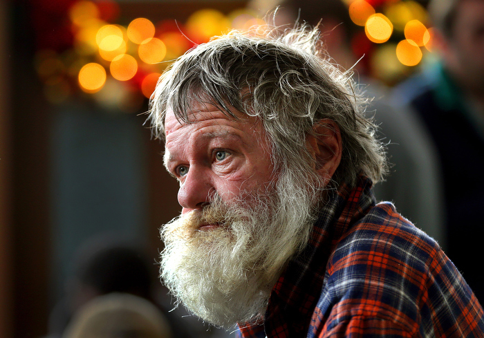 Boston 12/24/2013-   John Wuschke from South Boston has been homeless for three years. He waits for his lunch at the annual Christmas Eve lunch was served to close to 1000 homeless men and woman at the Pine Street Inn.