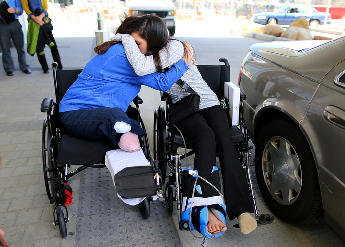 "Boston-5/03/13- Boston Marathon bombing survivors Celeste Corcoran from Lowell and her daughter Sydney hug at Spaulding Rehab Hospital as Sydney was discharged. Celeste lost both her legs and Sydney almost died after a massive leg injury tore her femoral artery. Sydney's departure both comforts and unsettles Celeste.""if Sydney would of died, I think I would of died with her."" Celeste said."
