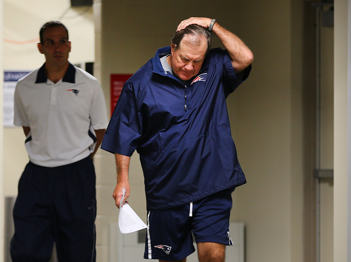 Foxborough-07/24/13 _ New England Patriots head coach Bill Belichick  walks into a press conference to speak about Aaron Hernandez at Gillette Stadium as training camp is set to open. It's the first time he talked about the alleged murder committed by former Patriots player Hernandez.