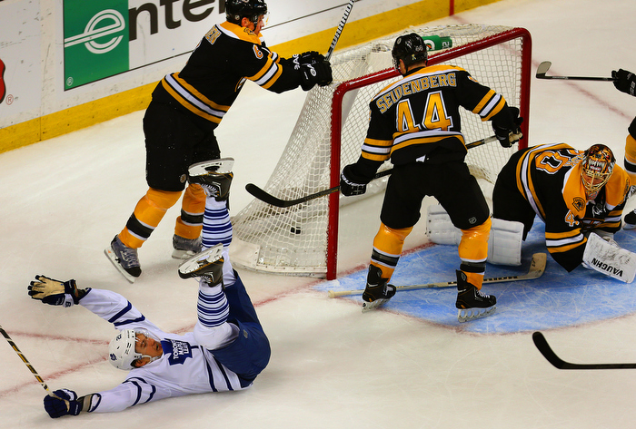 Boston-5/04/13-- Toronto's James van Riemsdyk celebrates on his back after his 3rd period goal putting Toronto up 4-2.  Bruins Wade Redden, Dennis Seidenberg and Tuukka Rask look on.
