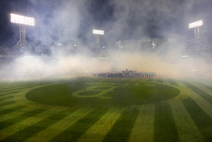 Boston-10/30/13--World Series game 6- Smoke from fireworks blankets the field at the end of the game, during the World Series trophy presentation in the infield, as B -Strong is legible again on the outfield grass.