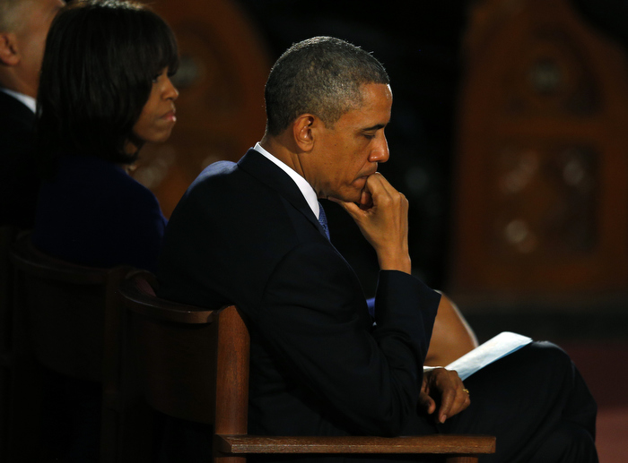 U.S. President Barack Obama and his wife Michelle attend an inter-faith memorial service for the victims of the bombing at the Boston Marathon in Boston, Massachusetts April 18, 2013.  Two explosions hit the Boston Marathon as runners crossed the finish line on Monday killing at least three people and injuring over 100 others.