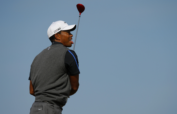 Tiger Woods of the U.S. watches his tee shot on the sixth hole during the third round of the British Open golf championship at Muirfield in Scotland July 20, 2013.