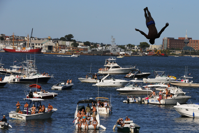 Michal Navratil of the Czech Republic dives off the roof of the Institute of Contemporary Art during the Red Bull Cliff Diving World Series 2013 competition in Boston, Massachusetts August 20, 2011. Divers plunge some 90 feet from the roof of the contemporary art museum into Boston Harbor.