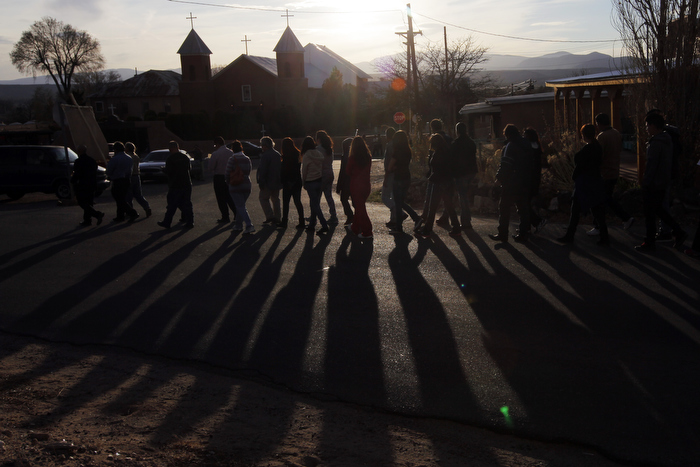 The faithful follow Hermanos from La Morada de Santa Cruz in a procession to Mass at Holy Cross Catholic Church in Santa Cruz,  New Mexico March 28, 2013.  The Hermanos are part of a centuries old lay Catholic group of men in northern New Mexico.