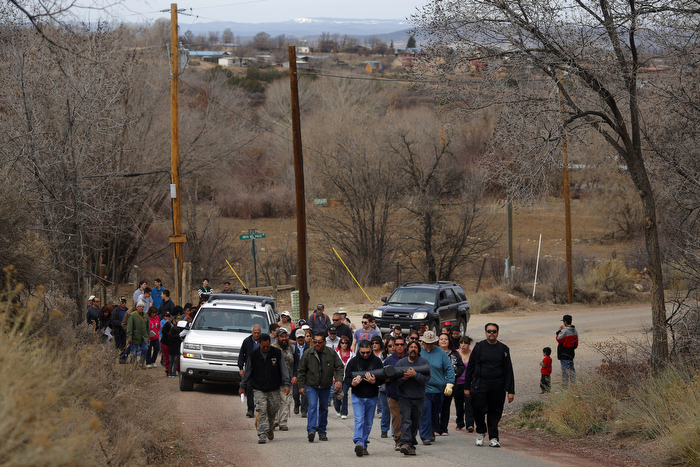 Men carrying a large cross lead a Good Friday pilgrimage in Ranchos de Taos, New Mexico March 29, 2013.  Several hundred followers of the Catholic Church walked a pilgrimage celebrating the Stations of the Cross from the San Francisco de Asis Catholic Church, through Ranchos de Taos and the remote village Talpa, New Mexico.
