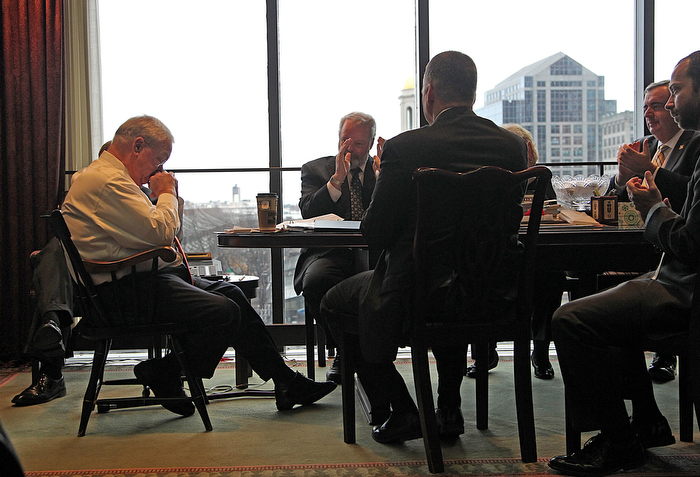 Boston, MA., 03/28/13, Mayor Thomas Menino---the longest sitting mayor in Boston's history----decides not to run for a fifth term. On the morning of the decision, he invites his inner staff to his offce to tell them inperson.  After heart felt words, the mayor--who has been in ill health for the last nine months, lowers his head on his hands as he struggles with his emotions.  From left to right, Menino, Peter Meade, head of the BRA, William Sinnott, Corporation Counsel, (back to camera), Angela Menino (mostly hidden), Boston Police Commissioner Ed Davis, Brian Swett, Chief of Environment and Energy.