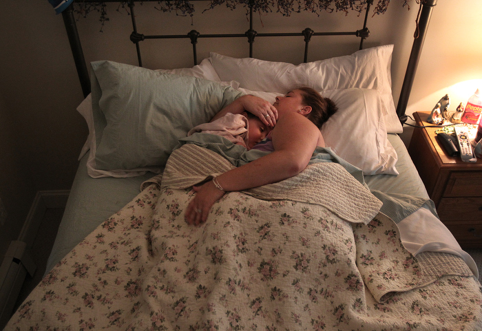 11. Ever since Calle's diagnosis, she has never slept alone---either her mother or father or aunt or grandparent sleeps with her. One July night Rachael lay next to Caroline in the room where she and her daughter slept. ÓDo you see God?Ó she asks her.  Caroline could no longer speak and had only slight movements. Her faltering system had begun to hunger for air, and all at once Rachael was coming to the realization that her daughter would not live, that the chemotherapy would not work and that no new cure would come. She felt a catch in her throat and began to cry. ÒIs he talking to you?Ó Rachael said. ÒIs he calling you?Ó Caroline stared back at her mother and slowly nodded her head.
