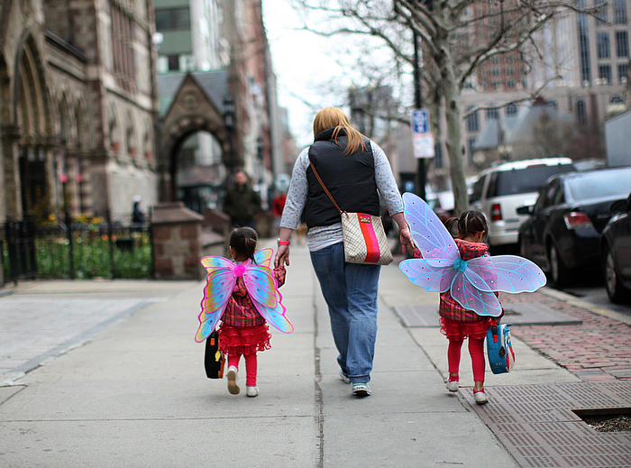 Boston, MA., 04/24/13, It was more than a week before Boylston Street opened up after the Boston Marathon Bombings at the finish line. It was a somber day with people visiting the scene of the terrorist attack. One family dressed their daughters up as angels as they made their way to school on Boylston Street.
