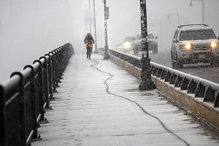 Snow and ice made for an unsteady yet determined bicycle commute across the Harvard Bridge over the Charles River.
