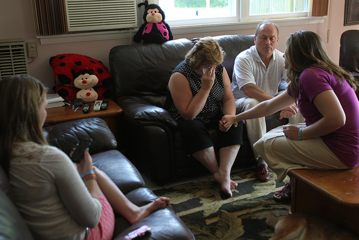 he Pelletier family, Lou and Linda, and their other daughters,  learn during a phone call that their daughter, Justina, will be going to foster care. On left is sister Julia who is on phone with Justina. Linda and Lou in center, with sister Jessica on right.