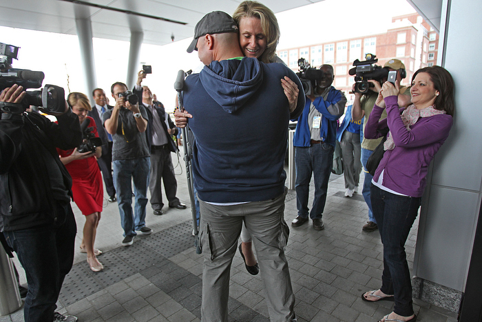 Charlestown MA., 05/14/13, Boston Marathon bombing survivor and amputee Roseann Sdoia was released from Spaulding Rehabilitation Hospital and was escorted to North End home by fire engines.  Boston Firefighter Mike Materia, is credited with helping to save Roseann Sdoia,cq, after the marathon bomb attack. He transporterd her in a police prisoner transport van when there were no ambulances. He held her hand and also held tight to her tourniquet to save her life. She lost a leg, but gained new friends, a new appreciation for life and a life-long gratitude to those how saved her life. At the end of the press conference, the hero firefighter picked her up to hug her.