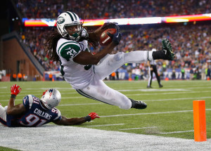 FOXBORO, MA - OCTOBER 16:  Chris Ivory #33 of the New York Jets is knocked out of bounds short of the goal line during the third quarter against the New England Patriots at Gillette Stadium on October 16, 2014 in Foxboro, Massachusetts.
