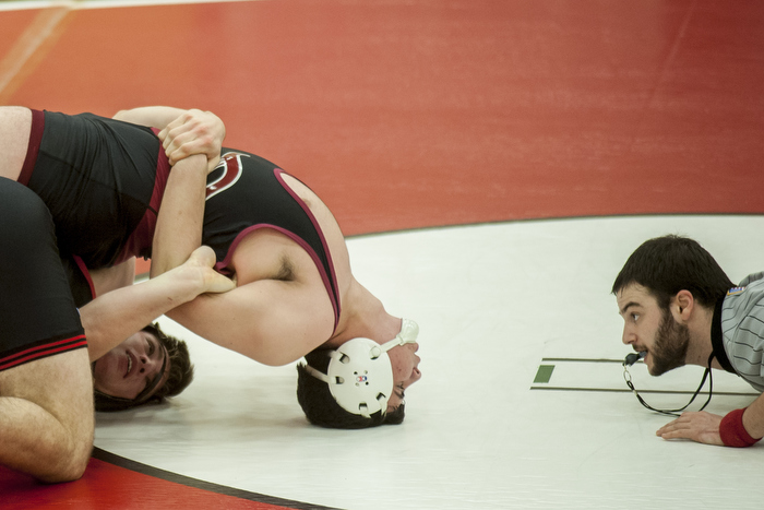 Wellesley wrestler Ned Stabnick (bottom) attempts to regain control in his match against Dedham wrestler Declan Heaslip (top), Dec. 23, 2014.