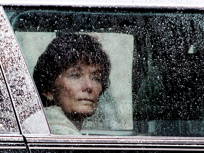 Natalie Jacobson looks out the rainy window of her limousine following the funeral of her former husband and popular co-anchor Chet Curtis at St. Cecilia's Church, Monday, January 27, 2014.