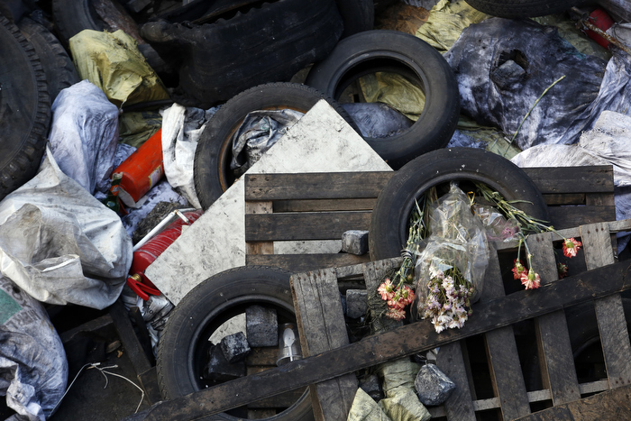 Kiev, Ukraine-- 03/20/2014--  Dried flowers are seen inside of a rubber tire, one of many that make up a giant makeshift barricade inside Maidan in Kiev, Ukraine March 20, 2014.