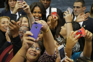 United States First Lady Michelle Obama (top C) poses for a photograph with audience members at a campaign rally for Democratic candidate for Rhode Island Governor Gina Raimondo in Providence, Rhode Island October 30, 2014.
