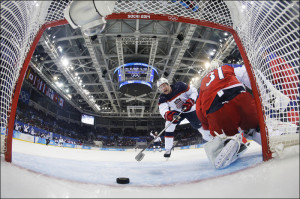 Team USA's David Backes (L) reacts as the puck crosses the goal line past Czech Republic's goalie Ondrej Pavelec during the second period of their men's quarter-finals ice hockey game at the 2014 Sochi Winter Olympic Games February 19, 2014.