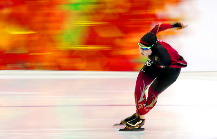 A German speed skater competes during the Sochi Olympics.