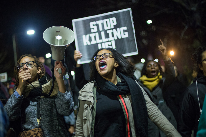 November 25, 2014 – Protestors march through Roxbury in Boston, Mass., after the grand jury in Ferguson, Mo., decided not to indict Officer Darren Wilson in the death of Michael Brown.